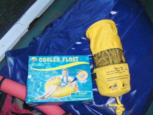 You need a Tow Tie Rope... Good if you have a waterproof bag so you can tie it to the dock And an inner tube with a place for drinks and an oar