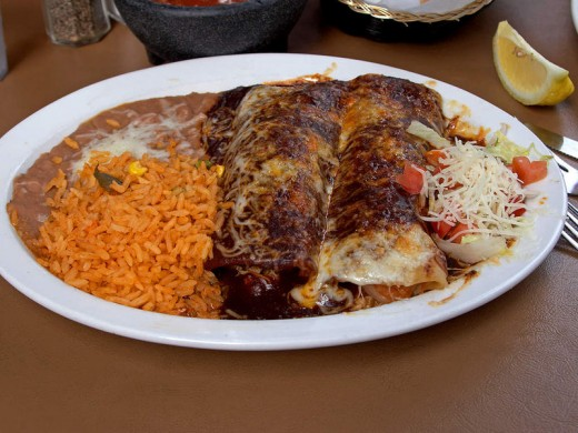 Enchilada, rice and beans.