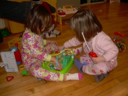 Playing with a friend at a PJ brunch birthday party
