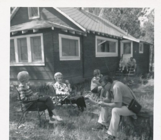 My grandad Jack  in foreground with his carving knife, binoculars and camera at our cabin in Colorado.
