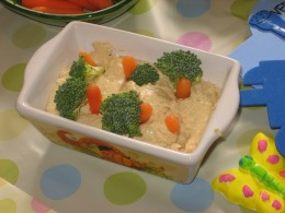 It's all in the presentation...this hummus dip vanished quickly when presented as a carrot patch, with broccoli-topped carrot sticks peeking out of the dip.