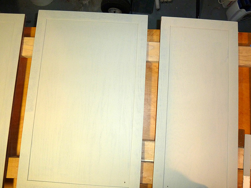 If your cabinets are in pretty good shape, a light sanding is the only thing needed prior to painting.