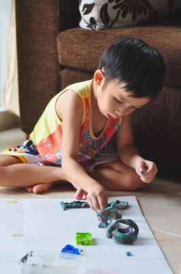It is not uncommon for children with autism to create patterns with their toys.