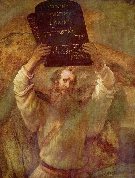 Moses with the Ten Commandments -- tablets of stone soon to be broken in his wrath.