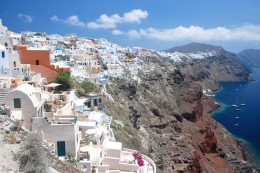 The island of Santorini, looking across the collapsed caldera and the buildings decorating the lip of it. Where is Atlantis? Not here.