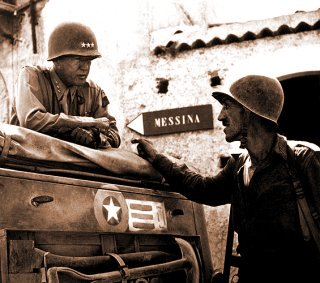 General George S. Patton, near Brolo, Italy, talking with Lt.Col. Bernard about military strategy. Patton remembered many past lives.