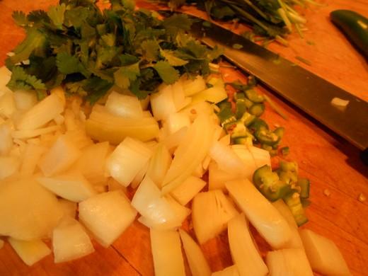 chop onions, green chili and fresh coriander (cilantro)