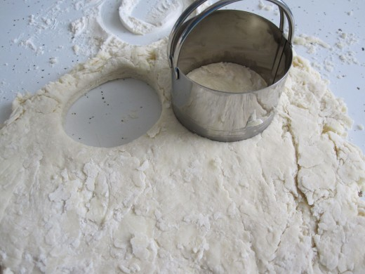 """Cutting out biscuit dough using 2.5"""" round cutter."""