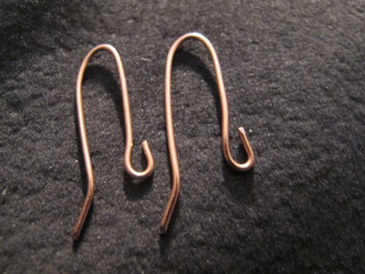 Slightly bend one end outward on each wire and create an open loop on the other end.