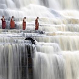 Buddhist monks at Pongua Falls, Vietnam.