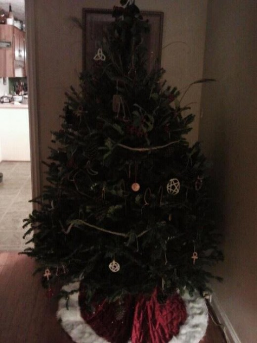 A yule tree; once solely a pagan practice for the winter solstice, now monopolized by Christianity. Here you see mostly all-natural ornaments and pagan symbols honoring the sun.