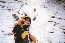 Building a snowman on a snow day is great fun!