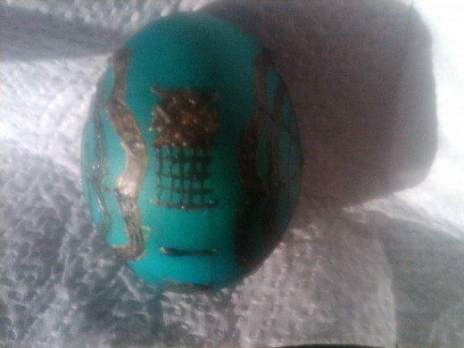Side view of blue egg