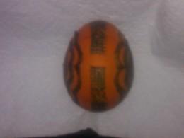 Side view of orange egg
