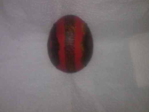 Side view of red egg