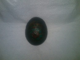 Black egg red outlines covered in wax