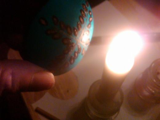 melting wax off egg