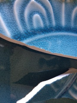 Broken blue dishes from fab online shopping site