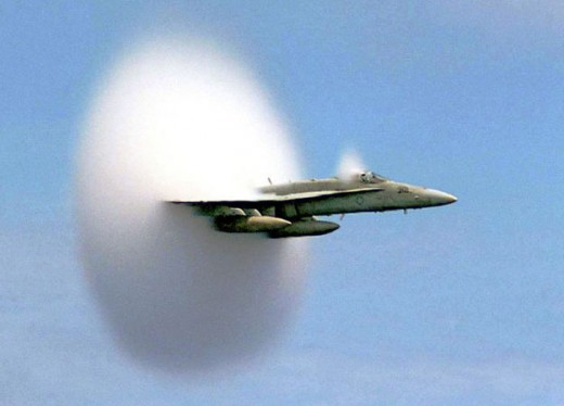 Sonic boom as a result of  shock wave.