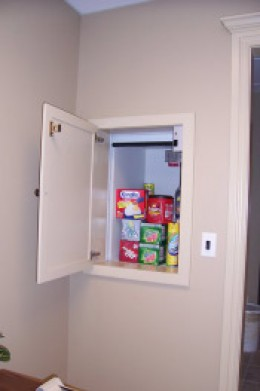 This shows a residential dumbwaiter loaded with some groceries.