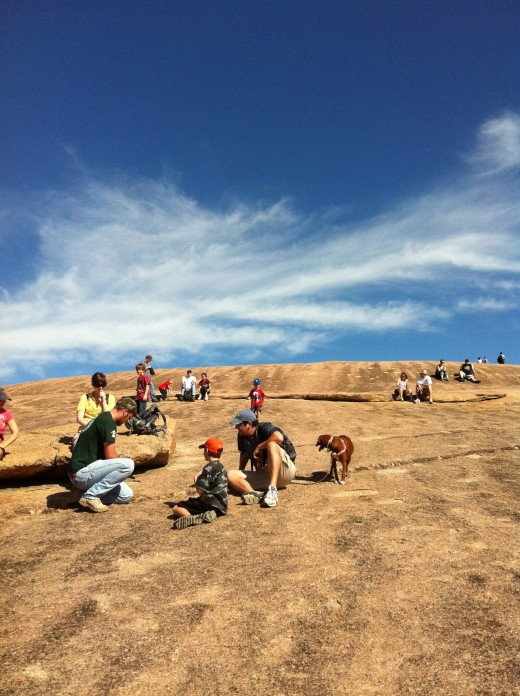 Families hiking with their pets at Enchanted Rock State Park