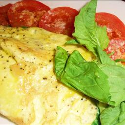 Cheese omelette with baby spinach and tomato