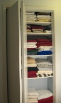 How to Paint Closely Spaced Closet Shelves