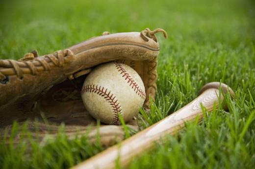 A baseball glove, bat and ball