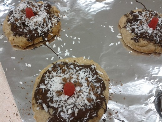 Finished cookies decorated with melted chocolate, coconut and candy