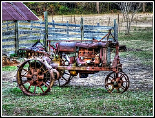 AN ANTIQUE TRACTOR SITS SILENT AFTER GIVING ITS OWNER ITS LIFE FOR SEVERAL CROPS, AND US, MANY THANKSGIVING MEALS WITH OUR FAMILIES.