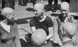 Manson women w/ shaved  heads in protest of Charley's  arrest