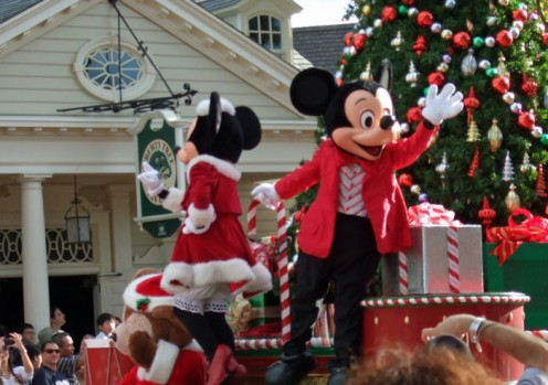 Mickey and Minnie leading the way in the Christmas parade at Magic Kingdom