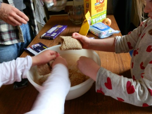 kids busy breaking up the shredded wheat