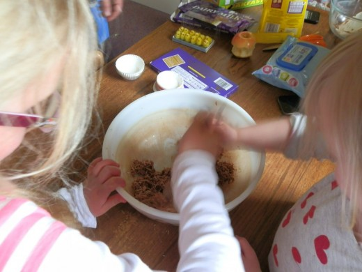 the kids stir in the melted chocolate to the grains