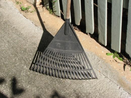 An inexpensive, plastic garden leaf rake.