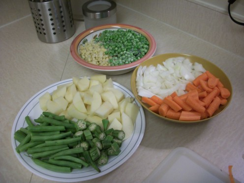 Wash, dry, and cut up raw vegetables