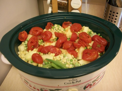 Add vegetables and tomatoes on top of prepared stew meat