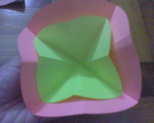 put the yellow paper into the middle of pink paper