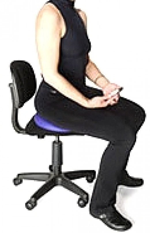 Active Sitting using a Fit-ball disk and sitting forward of the back-rest for short periods of time