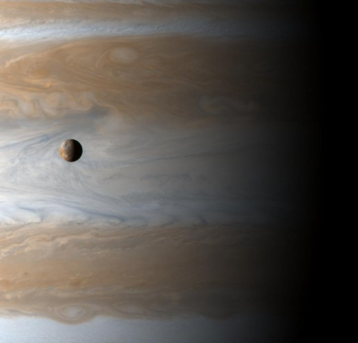 Io is about the same size as our moon, but Jupiter is so massive that you could snuggle four Earths inside its Great Red Spot, a tornado that's been going since Gallileo first spotted it.
