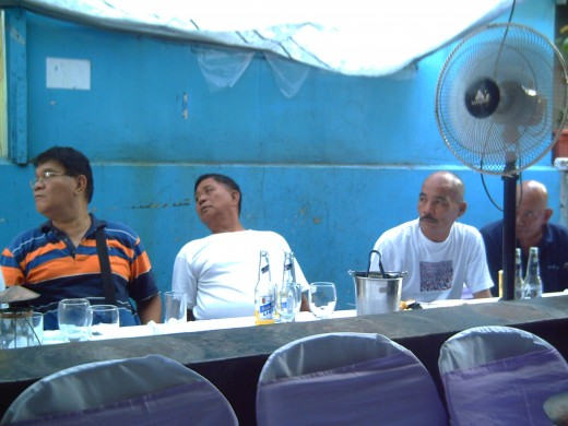 Elderly men outside the home where the Pasyon ni Kristo is being sung (Photo by Travel Man)