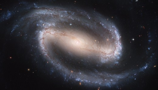 I loved drawing barred galaxies when I was a kid: a half spiral, a bar, and another half spiral, like an intergalactic belt buckle. Thanks to Hubble, we can finally get a better idea what we're seeing.