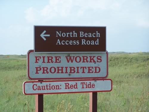 Signs warning beach goers and fishermen.