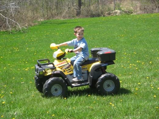 Grandson Alec in the backyard