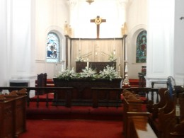 Inside the church, the altar decorated for the 8.30 AM service.