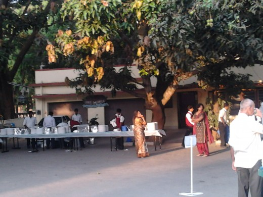 As the first rays of light catch the large mango tree, in front of the parsonage, breakfast is being laid out for the congregation.