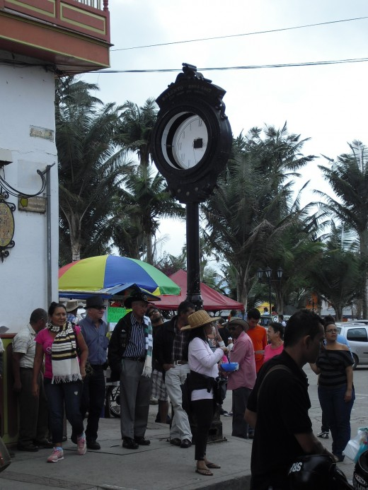Old clock and crowds of people