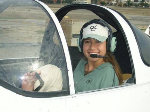 In the cockpit, ready to take off, Jessica Cox flies a plane with no arms!