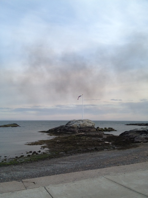 smoke passing the American Flag at Anchor Beach