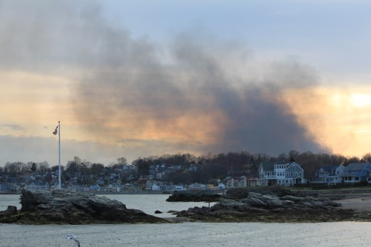 smoke from brush fire fills the horizon as it spills over long island sound